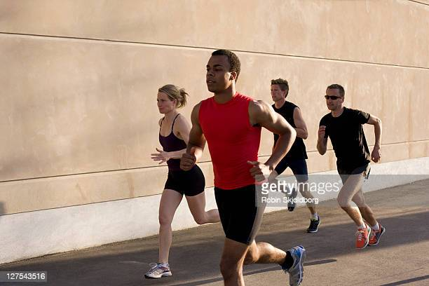 runners jogging together - atleta papel social fotografías e imágenes de stock