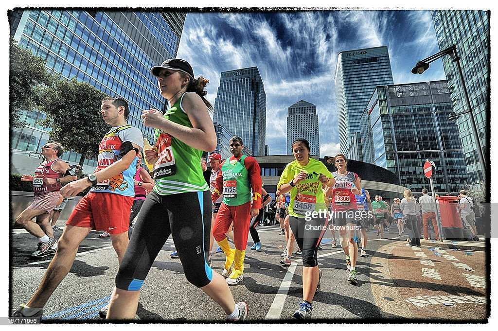 Runners leave Canary Wharf behind at the nineteen mile mark during the Virgin London Marathon 2013 on April 21, 2013 in London, England.