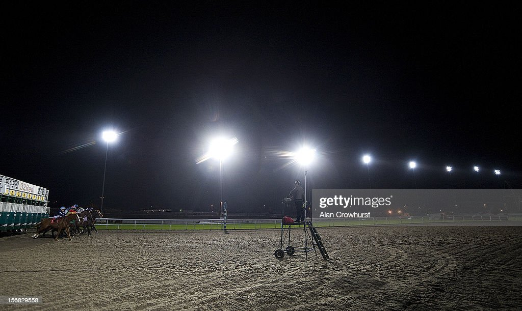 Runners leave the stalls in The 32Red Handicap Stakes at Kempton racecourse on November 22, 2012 in Sunbury, England.