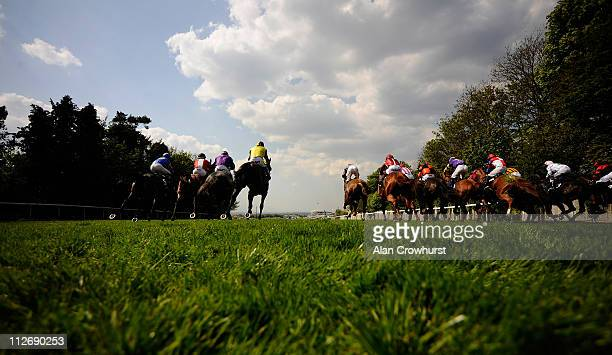 Runners leave the stalls in the Investec Asset Management Handicap Stakes over 5 furlongs during Epsom Races at Epsom racecourse on April 20, 2011 in...