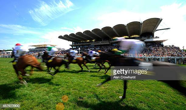 Runners leave the start in The Goodwood Stakes at Goodwood racecourse on July 30 2014 in Chichester England