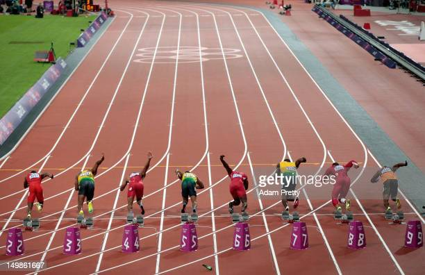 Runners leave the starters block to start the Men's 100m Final on Day 9 of the London 2012 Olympic Games at the Olympic Stadium on August 5, 2012 in...