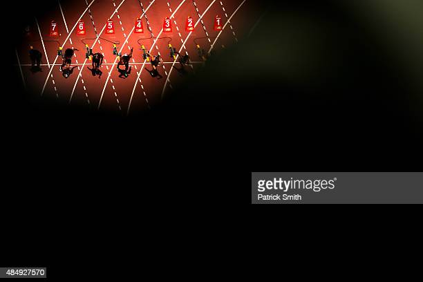 Runners leave the starting blocks during the Women's 100 metres heats on day two of the 15th IAAF World Athletics Championships Beijing 2015 at...
