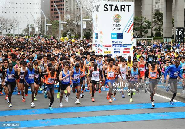 Runners leave the starting line of the 12th Tokyo Marathon in front of the Tokyo Metropolitan Government in Tokyo Japan on February 25 2018