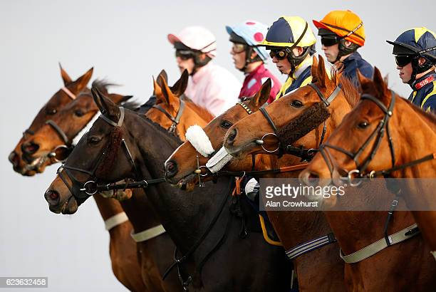 Runners line up for the start of The 188Bet Handicap Steeple Chase at Chepstow Racecourse on November 16 2016 in Chepstow Wales