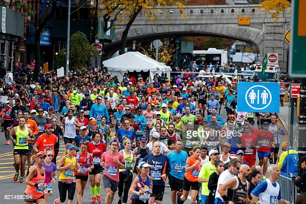 Runners make the turn onto First Avenue after crossing the Queensboro Bridge during the 2016 TCS New York City Marathon November 6 2016 in New York...