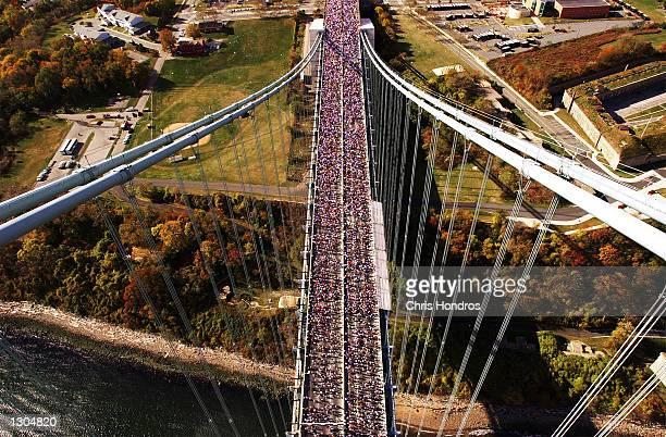 Runners make their way across the Verrazano Narrows Bridge in New York November 5 2000 at the start of the New York City Marathon Over 30000...