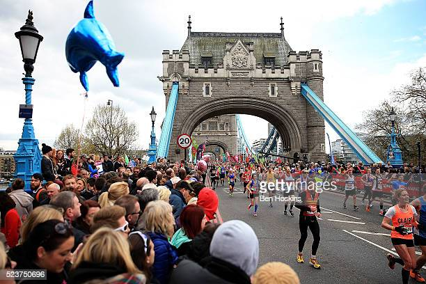 Runners make their way across Tower Bridge during the Virgin Money London Marathon on April 24 2016 in London England