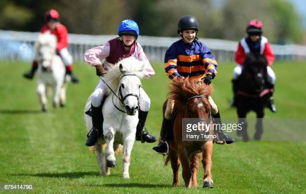 Runners make their way around the course during the Shetland Pony Race at Bath Racecourse on May 1 2017 in Bath England