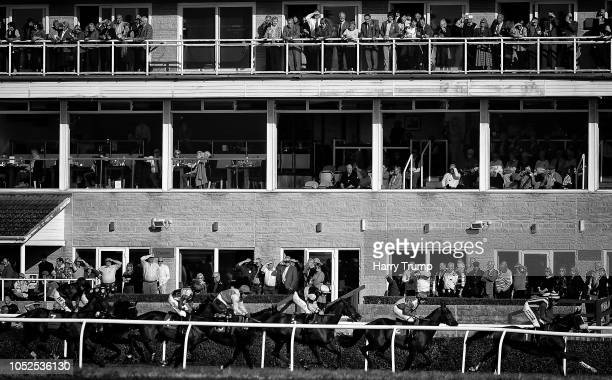 Runners make their way around the course during the Smarkets Handicap Chase at Wincanton Racecourse on October 19 2018 in Wincanton England