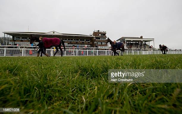 Runners make their way back to the horseboxes after racing during the last meeting to be held after 114 years of racing at Folkestone racecourse on...