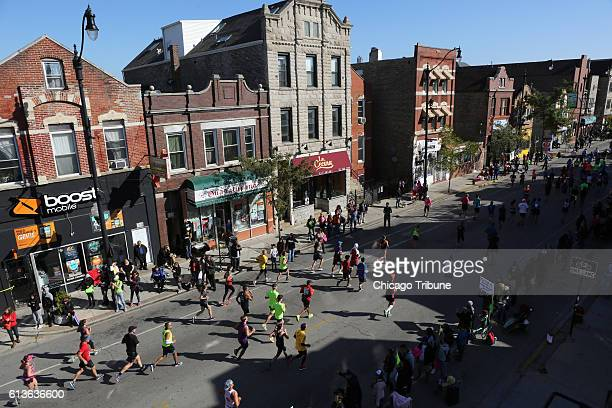 Runners make their way down 18th Street as they participate in the Bank of America Chicago Marathon on Sunday Oct 9 2016 More than 41000 runners...