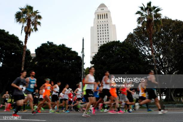 Runners make their way down 1st Street near City Hall during the 2020 Los Angeles Marathon on March 08 2020 in Los Angeles California