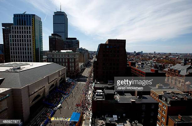 Runners make their way down Boylston Street near the finish line during the 2014 BAA Boston Marathon on April 21 2014 in Boston Massachusetts Today...