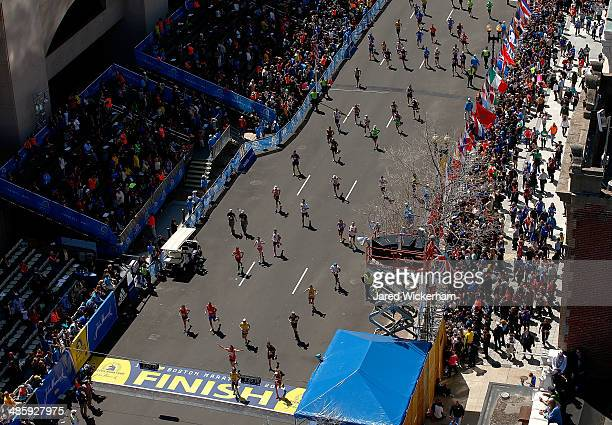 Runners make their way down Boylston Street near the finish line during the 2014 B.A.A. Boston Marathon on April 21, 2014 in Boston, Massachusetts....