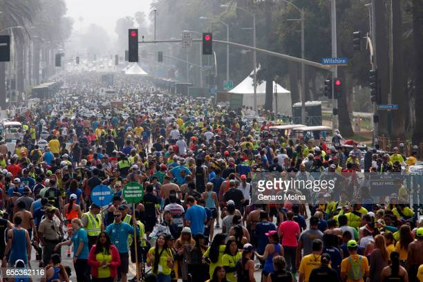 Runners make their way down Ocean Avenue after completing the 32nd annual Los Angeles Marathon in Santa Monica on March 16 2017