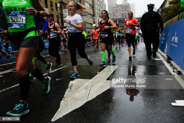 Runners make their way in Manhattan during 2017 TCS New York City Marathon November 5 2017 in New York NYPD department had doubled the number of...