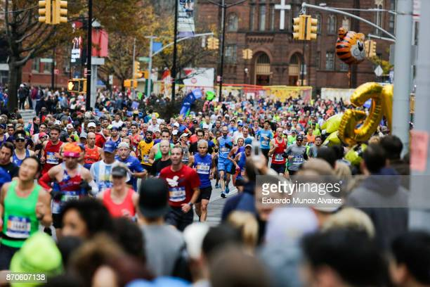 Runners make their way on Lafayette Avenue during the 2017 TCS New York City Marathon November 5 2017 in the Brooklyn borough of New York City NYPD...