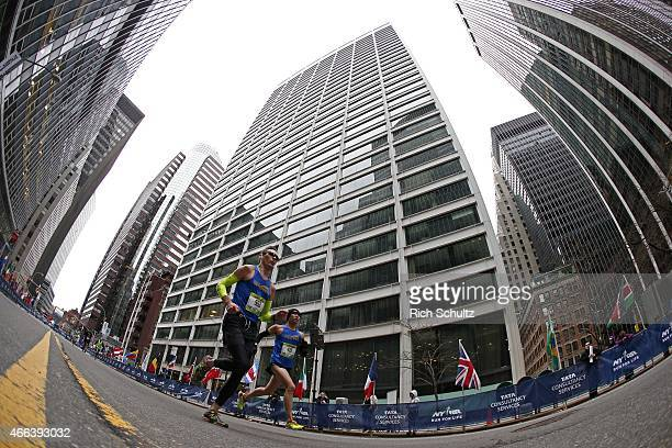 Runners make their way on Water Street to the finish line at the 2015 United Airlines New York City Half Marathon in lower Manhattan on March. 15,...