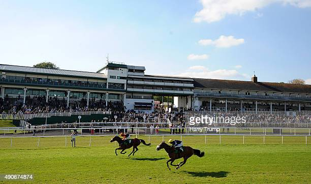 Runners make their way past the grandstand at Chepstow Racecourse on September 30 2015 in Chepstow Wales