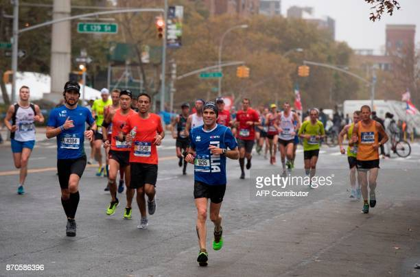 Runners make their way through the Bronx as they compete during the 2017 TCS New York City Marathon in New York on November 5 2017 Five days after...