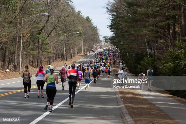 Runners make their way through the half way mark of the marathon in Wellesley Massachusetts