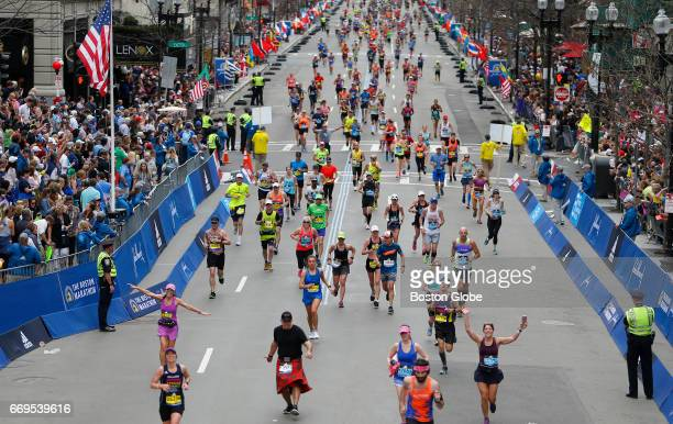 Runners make their way toward the finish line of the 121st Boston Marathon in Boston on Apr 17 2017