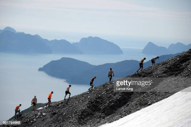 Runners make their way toward the top of Mount Marathon during the Men's Division of the 91st Running of the Mount Marathon Race on July 4 2018 in...