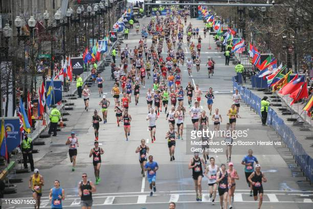 Runners make their way towards the finish line of the 123rd Boston Marathon on Monday April 15 2019 in Boston Massachusetts
