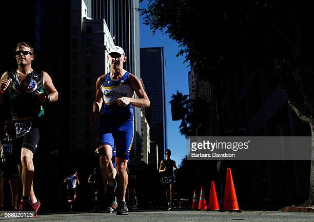 Runners make their way up Grand Ave. Towards Staples center Sept. 29, 2013 in downtowm Los Angeles durind Sunday's 14th annual Herbalife Triathlon....