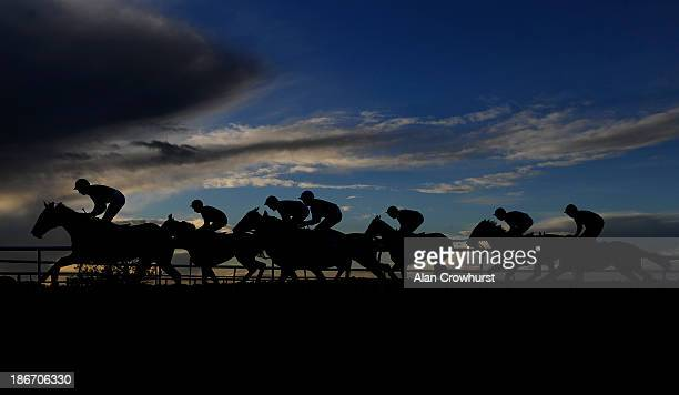 Runners make their way up the home straight at Carlisle racecourse on November 03 2013 in Carlisle England