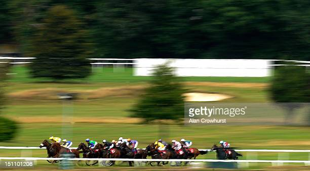 Runners make their way up the straight five furlong course in The Piper Heidsieck Champagne Handicap Stakes at Sandown racecourse on September 01,...