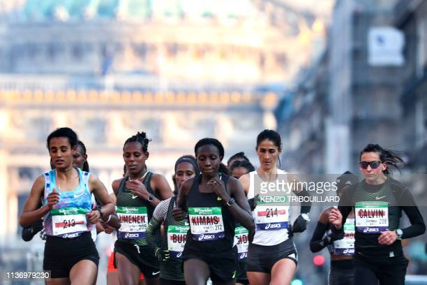 Runners of the Elite Women group compete with France's Clemence Calvin compete during the 43rd edition of the Paris Marathon on April 14 2019 in...