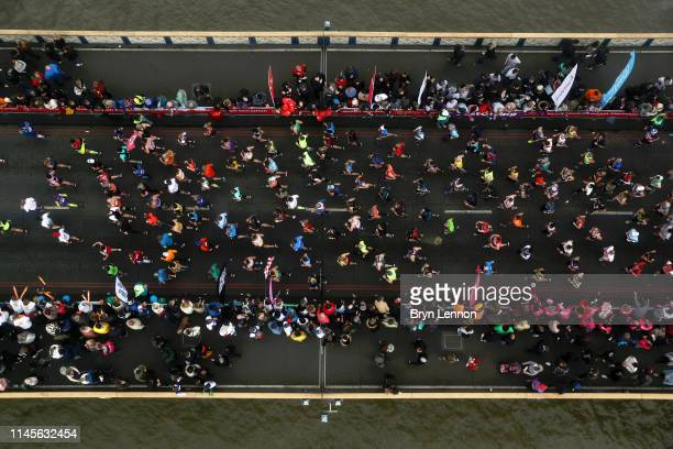 Runners of the London Marathon are seen from Tower Bridge's Glass Floor during the Virgin Money London Marathon at United Kingdom on April 28 2019 in...