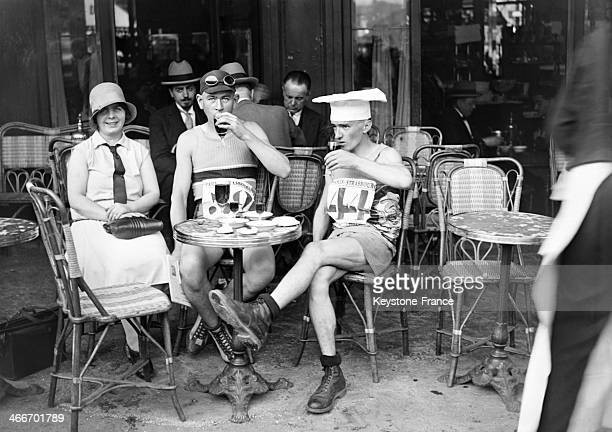 Runners of the Paris Strasbourg race having a drink a few minutes before the start in 1929 in Paris France