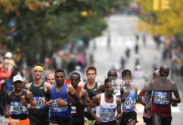 Runners of the Professional Men's Division lead the field during the 2017 TCS New York City Marathon on November 5 2017 in New York City