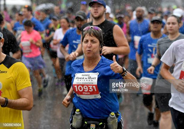 Runners of the Rock n Roll Chicago Half Marathon and 10K leave the starting line on July 22 2018 in Chicago Illinois