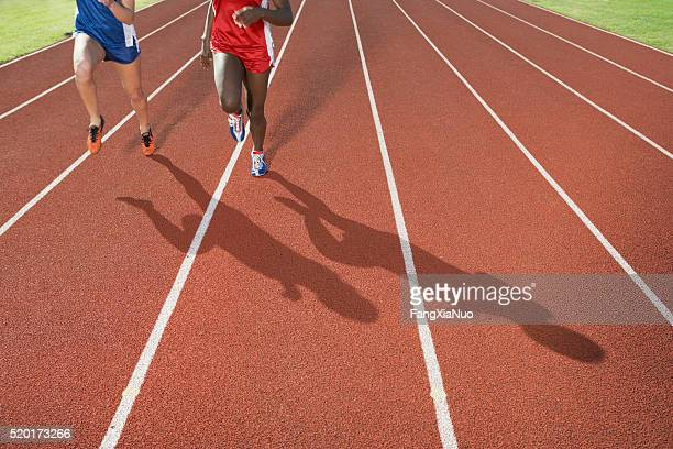 runners on a track - finishing stock pictures, royalty-free photos & images