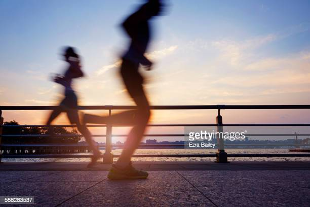 Runners on an early morning jog in the city.