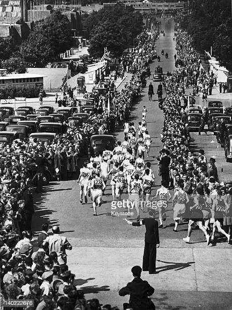 Runners on Olympic Way outside Wembley Stadium at the start of the marathon at the London Olympics 7th August 1948