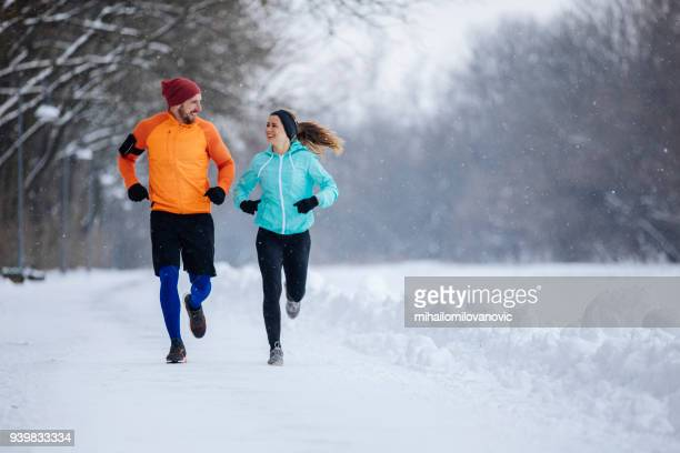 runners on the snow - winter weather stock photos and pictures