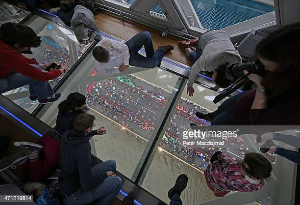 Runners on The Virgin Money London Marathon cross the River Thames as seen from The Tower Bridge Exhibitions Glass Flooring on April 26, 2015 in...
