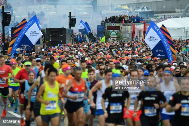 Runners participate during the 2017 TCS New York City Marathon in New York on November 5 2017 Five days after the worst attack on New York since...