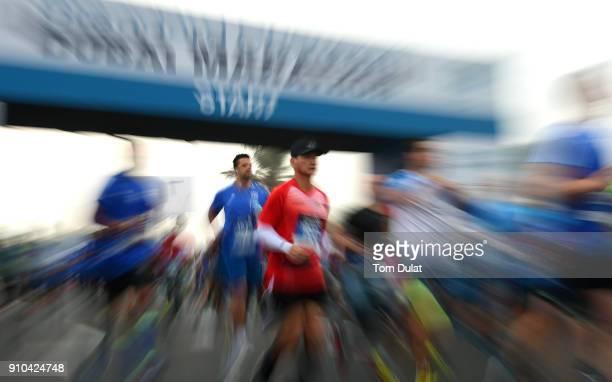 Runners participate in Standard Chartered Dubai Marathon on January 26 2018 in Dubai United Arab Emirates