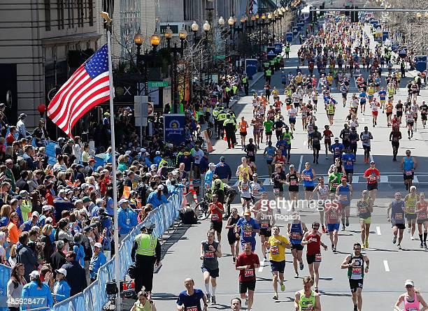 Runners participate in the 2014 BAA Boston Marathon on April 21 2014 in Boston Massachusetts