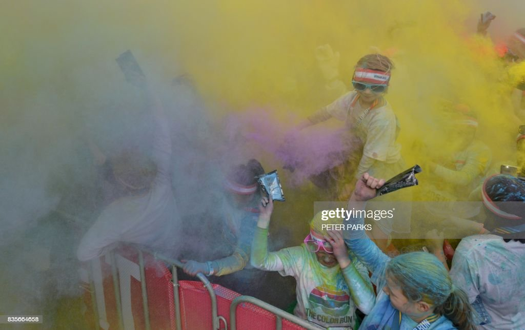 Runners participate in the annual Color Run in Centennial Park in Sydney on August 20, 2017. The Color Run is a 5km fun run started in the US in 2012 and is inspired by the traditional Hindu festival Holi, where people throw natural coloured powders as the seasons change from winter to spring. /