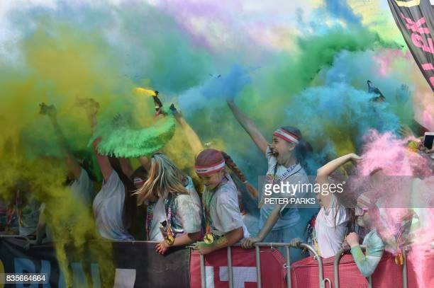 Runners participate in the annual Color Run in Centennial Park in Sydney on August 20 2017 The Color Run is a 5km fun run started in the US in 2012...