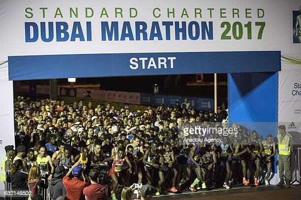 Runners participate in the Standard Chartered Dubai Marathon 2017 in Dubai United Arab Emirates on January 20 2017