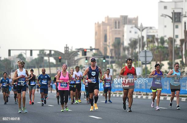 Runners participate in the Standard Chartered Dubai Marathon 2017 on January 20 2017 in Dubai United Arab Emirates