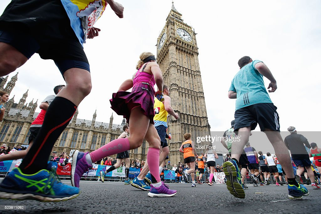 Runners pass Big Ben during the Virgin Money London Marathon on April 24, 2016 in London, England.